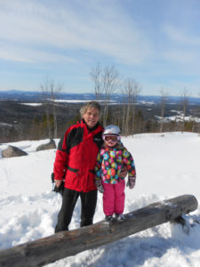 My granddaughter, Maya, and I - out for great day of snowmobiling in the Lakes Region!