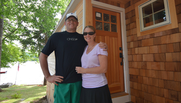 James and Jamie McCuddy in front of their Lake Winnipesaukee waterfront home