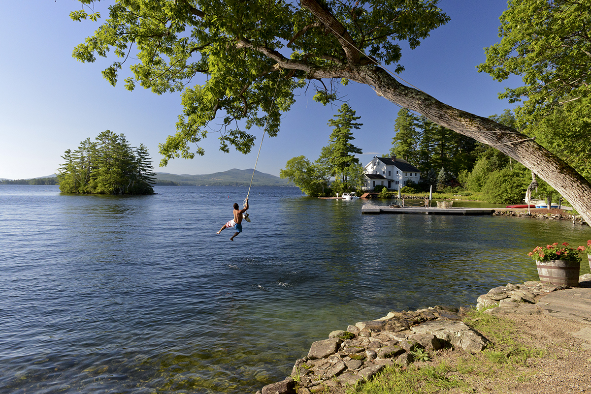 Guy on rope swing lake winnipesaukee NH