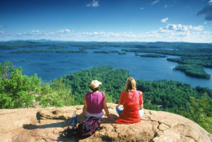 "Hikers overlooking the lake in New Hampshire, voted ""Best State to Live in America"" in 2020."
