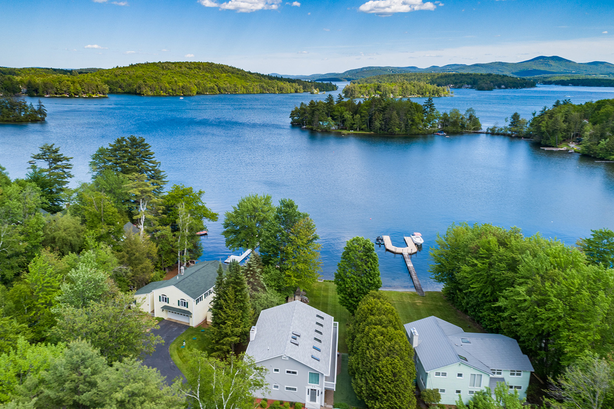 NH Lake Sales Activity - picture of lake with mountains and homes