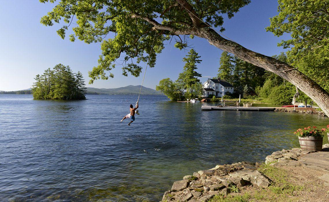 Guy on rope swing lake winnipesaukee NH