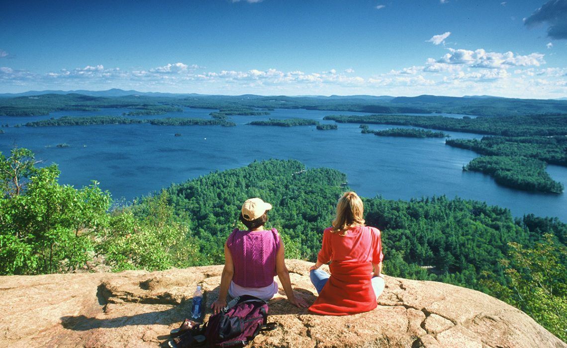 Hikers overlooking the lake in New Hampshire, voted