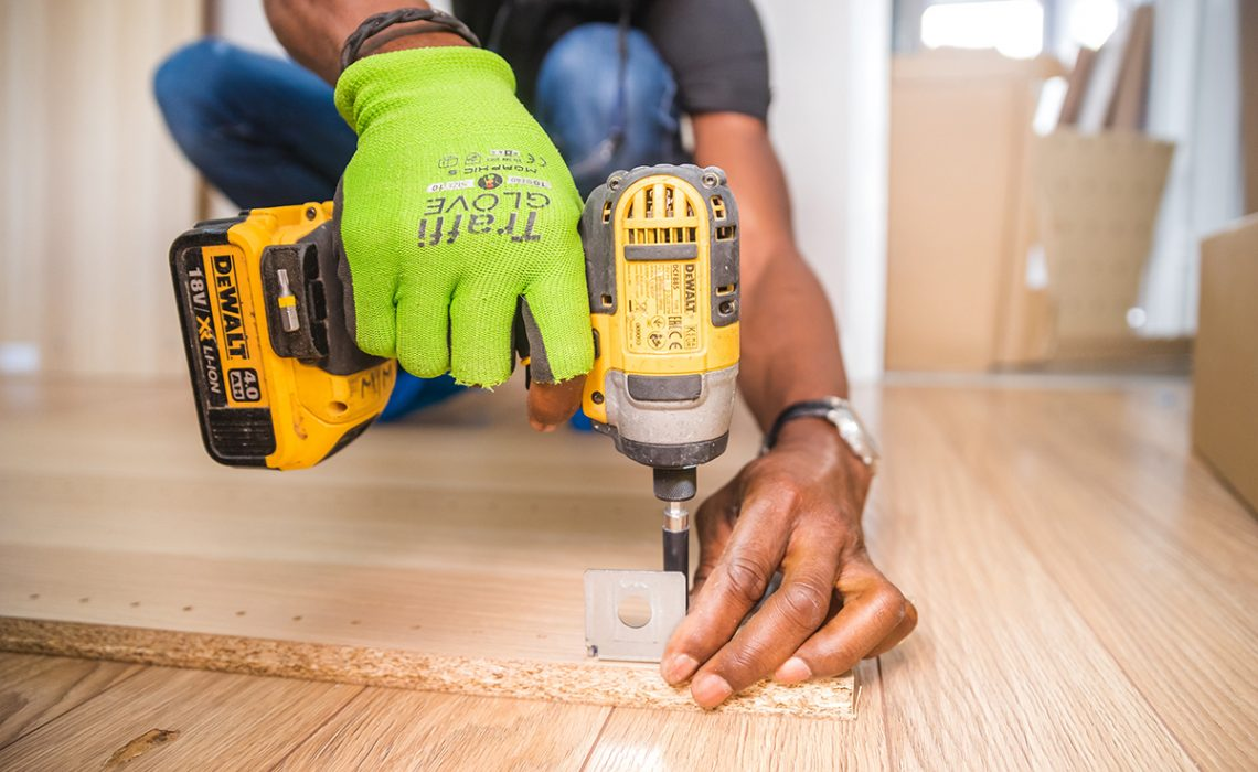 Picture of a carpenter working on a floor